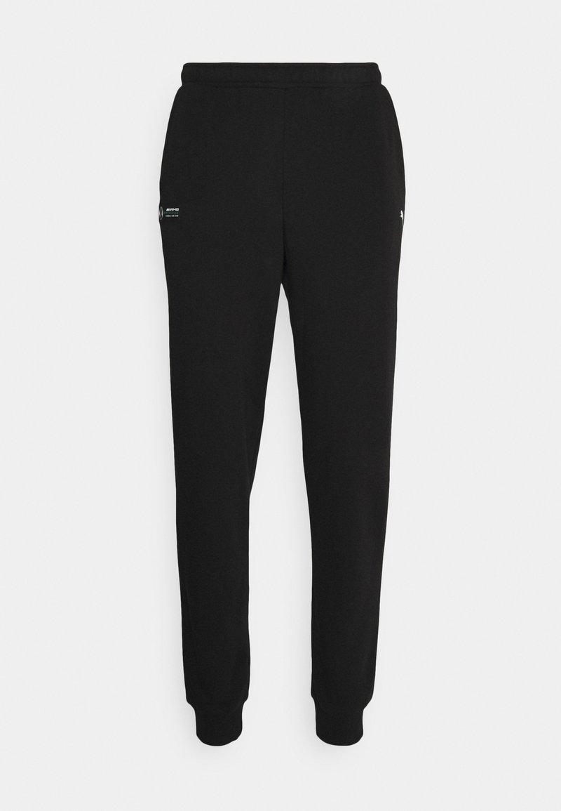 Puma - ESSENTIAL PANTS - Tracksuit bottoms - black