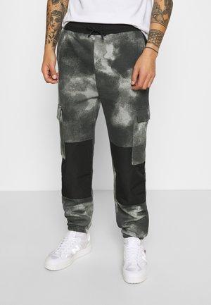 TIE DYE TEXTURE MIX - Tracksuit bottoms - charcoal