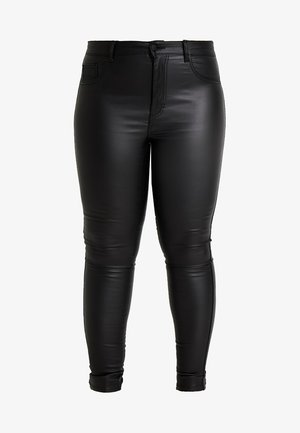 CARPUNK COATED - Trousers - black