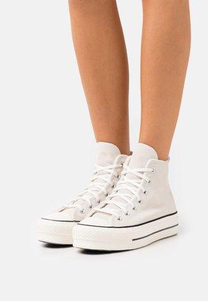 CHUCK TAYLOR ALL STAR LINED PLATFORM - Sneakers hoog - egret/black