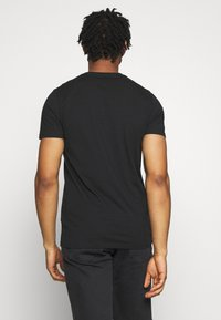 Hollister Co. - SOLIDS  - Basic T-shirt - black - 2