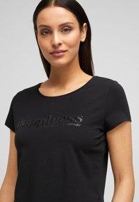 s.Oliver BLACK LABEL - Print T-shirt - black placed wording - 3