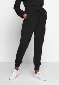 Kaffe - KASIGGI LINDA PANTS  - Cargo trousers - black deep - 0