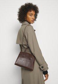 Little Liffner - MINIMAL MINI TOTE - Handbag - dark brown - 0