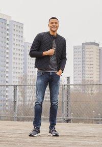Replay - ANBASS BIO - Slim fit jeans - dark blue - 1