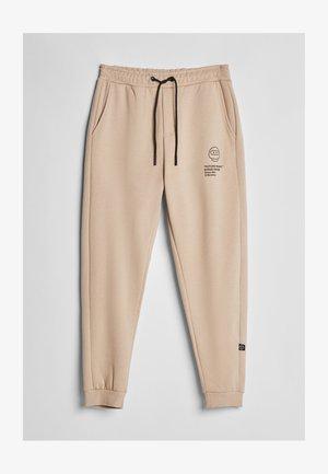 FUTURE-READY  - Teplákové kalhoty - beige