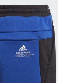 adidas Performance - Tracksuit bottoms - black - 6