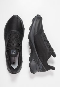Salomon - ALPHACROSS GTX - Trail running shoes - black/ebony - 1