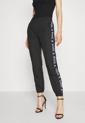 TRACKPANTS - Jogginghose - black