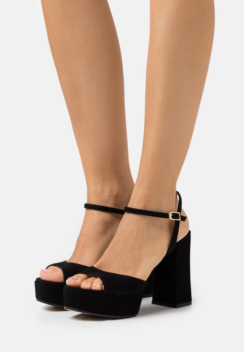Unisa - VEGARA - Platform sandals - black