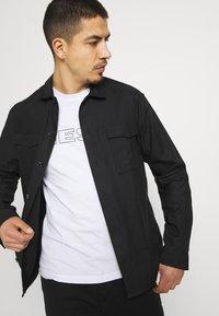 Diesel - 2 PACK - T-shirt con stampa - black/white - 4