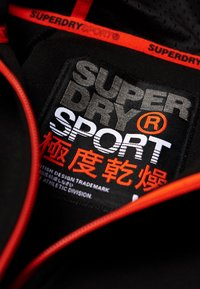 Superdry - GYM TECH STRETCH  - Training jacket - black - 4