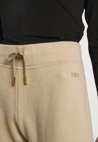 Bally - LUX TRACK PANTS - Tracksuit bottoms - camel - 4