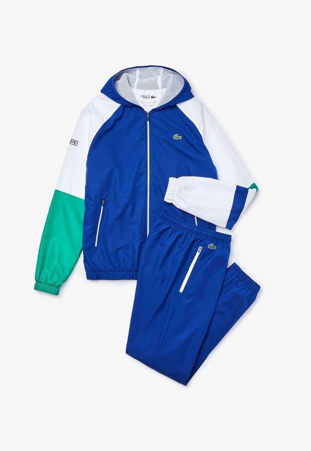 WH2043 - Survêtement - bleu / blanc / vert / noir