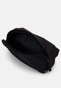 Puma - WAIST BAG UNISEX - Bum bag - black - 2
