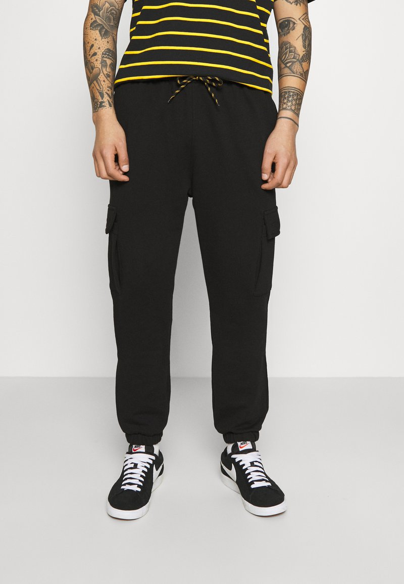 Caterpillar - Pantalones deportivos - black