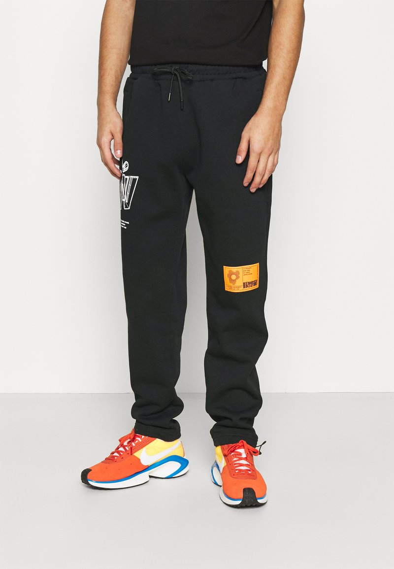 Topman - PRINTED BUNGY - Tracksuit bottoms - black