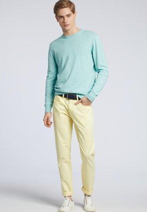 Spodnie materiałowe - yellow