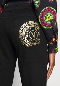 Versace Jeans Couture - Jeans Skinny Fit - black denim - 10