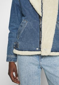 Calvin Klein Jeans - MOTO JACKET - Denim jacket - mid blue - 8