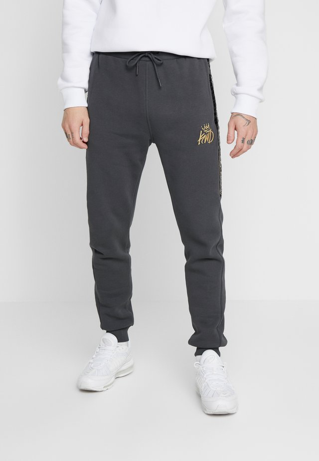 ZEBRA JOGGERS - Tracksuit bottoms - black