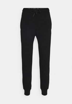PETER TROUSERS - Pantalones deportivos - black