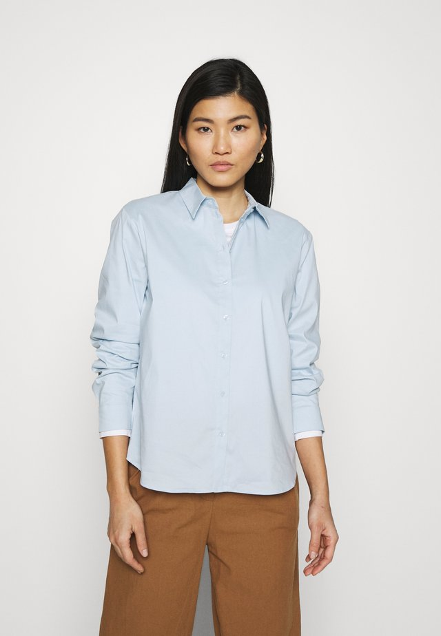 BLOUSE - Button-down blouse - light blue