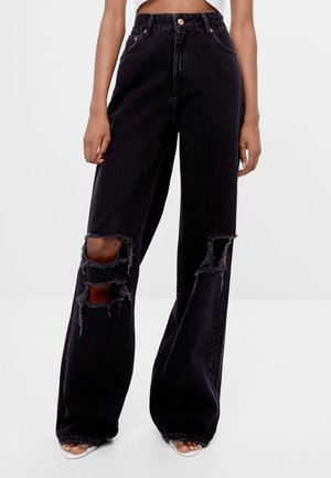 MIT SCHLAGHOSE UND RISSEN - Relaxed fit jeans - black