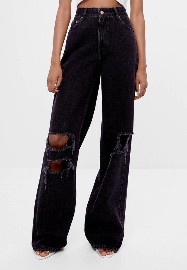 MIT SCHLAGHOSE UND RISSEN - Jeans relaxed fit - black