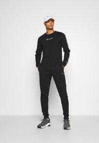 Champion - CUFF PANTS - Pantaloni sportivi - black - 1
