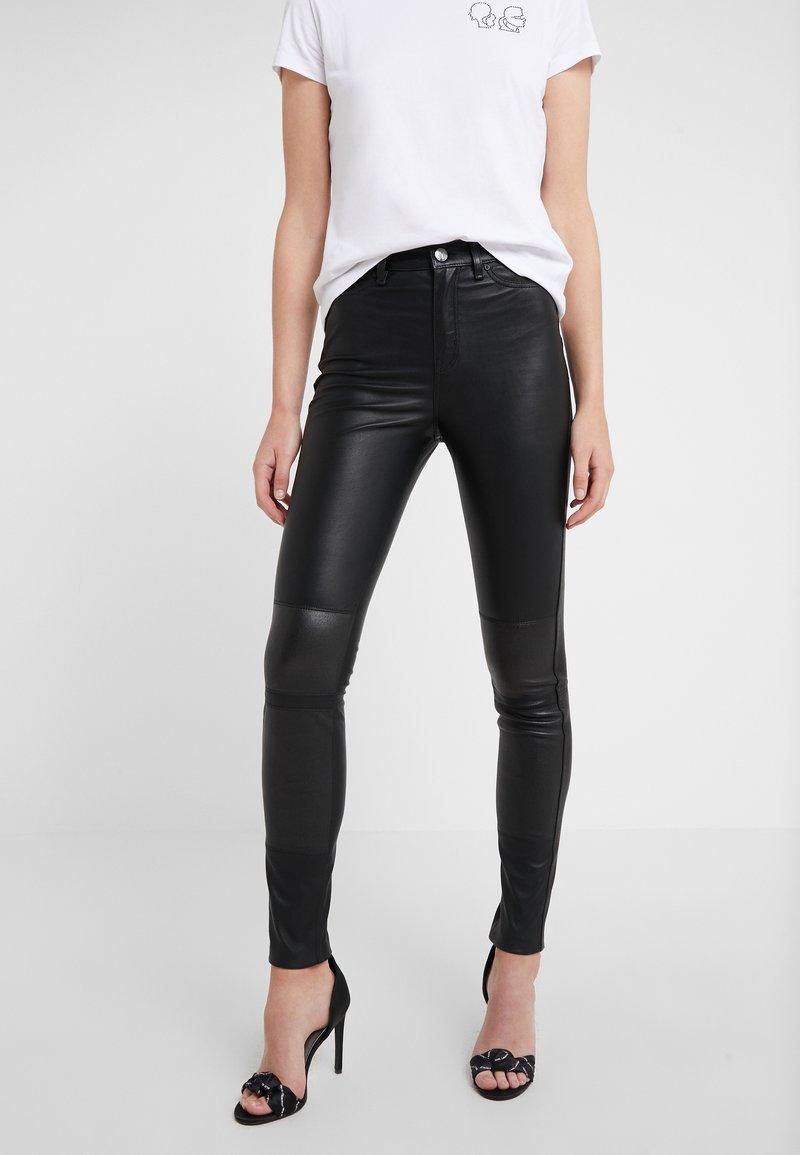 KARL LAGERFELD - PATENT BIKER PANTS - Leather trousers - black