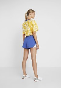 Tommy Sport - GRAPHIC TEE - Print T-shirt - yellow - 2