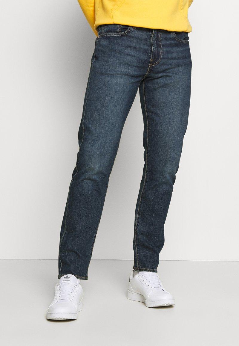 Levi's® - 502™ REGULAR TAPER - Jeans Tapered Fit - dark indigo/worn in