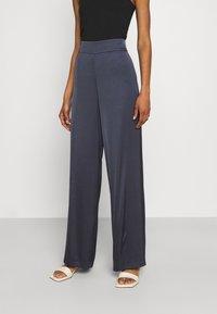 HUGO - HAREMAS - Trousers - dark blue - 0