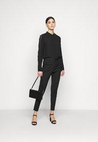 Vero Moda Tall - VMVICTORIA ANTIFIT ANKLE PANTS - Trousers - black - 1