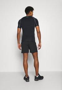Jack & Jones - JCORUNNING SHORTS  - Sports shorts - black - 2