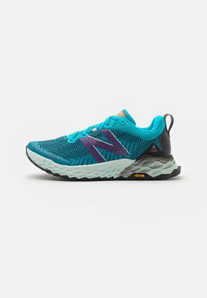 HIERRO - Trail running shoes - turquoise