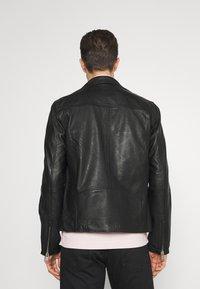 Selected Homme - SLHICONIC BIKER  - Leather jacket - black - 2
