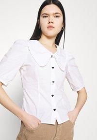 Monki - SANDRA BLOUSE - Button-down blouse - white - 3