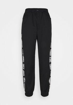 JOGGER TAPE RELAXED - Teplákové kalhoty - black