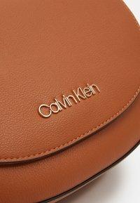 Calvin Klein - SADDLE BAG - Across body bag - brown - 3