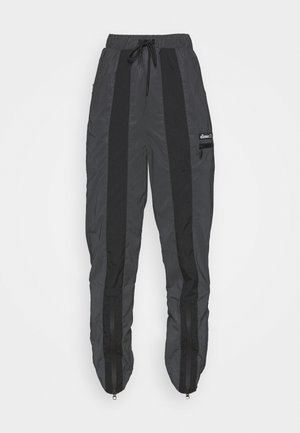 REFLECTIVE EQUES - Tracksuit bottoms - black