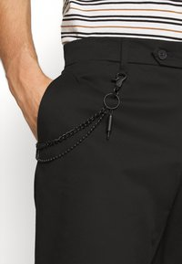 Antony Morato - TROUSERS JAGGER CARROT FIT IN STRETCH FABRIC - Trousers - black - 4