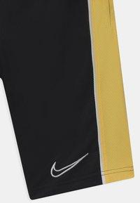 Nike Performance - UNISEX - Pantalón corto de deporte - black/saturn gold/white - 2