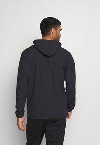 Puma - TRAIN VENT JACKET - Training jacket - black - 2