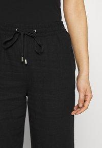 Marks & Spencer London - TAPERED - Trousers - black - 4