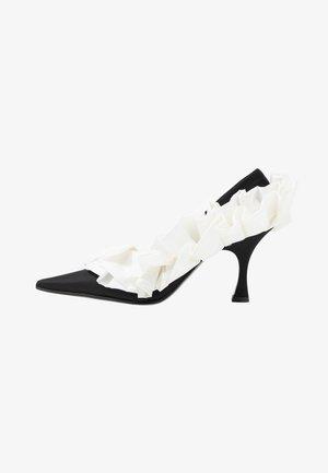 Klassiska pumps - black/white