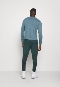 Nike Performance - ELITE PANT - Tracksuit bottoms - seaweed/reflective silver - 2