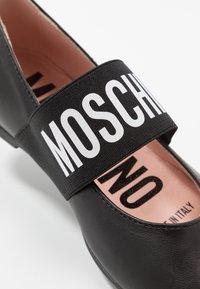 MOSCHINO - Ankle strap ballet pumps - black - 2