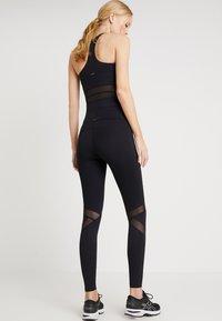 Daquïni - FLUXUS - Leggings - Trousers - black - 2